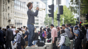 Make my day: Trumpeter Phil Day is a familiar sight at Southern Cross station during morning peak hour.