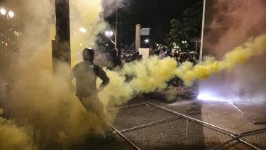 Militarised federal agents fire tear gas in Portland, Oregon.