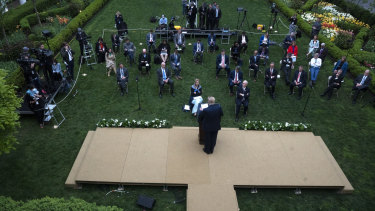 US President Donald Trump speaks during a news conference in the Rose Garden of the White House in Washington DC.