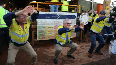 Prime Minister Scott Morrison joins Fortescue Metals Group's CEO Andrew Forrest in morning stretches during a tour of the Christmas Creek mining operations, before visiting Kalbarri.