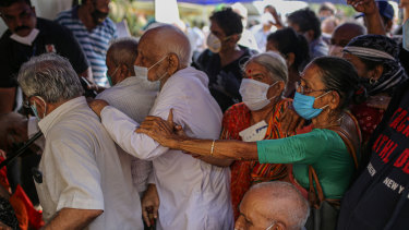 Elderly Indians queue at a vaccination centre in Mumbai.