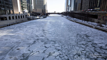 Ice floats on the Chicago River in Chicago on Wednesday.