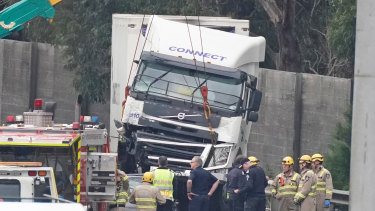 Crash investigators at the scene the day after four police  were struck and killed by a truck on the Eastern Freeway.