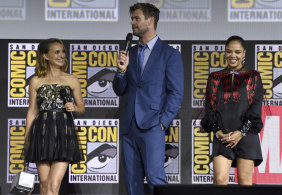 Promoting Thor: Love and Thunder: Natalie Portman with Chris Hemsworth and Tessa Thompson at the 2019 Comic-Con in San Diego.