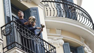 Madrid residents bang pots angrily after reports that King Juan Carlos took Saudi kickbacks.