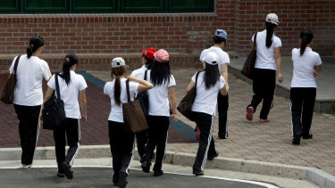 In this 2009 file photo, women who defected from North Korea walk to class at a state-run shelter for defectors.