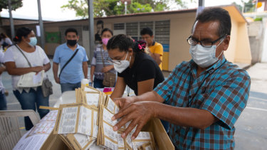 A polling station official counts votes on  in Petaquillas, Mexico, on Sunday.
