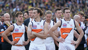 A dejected Phil Davis of the Giants (second from left) during the presentations after the 2019 AFL grand final.