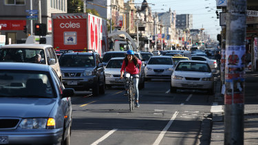 Cyclists take their chances on Sydney Road.