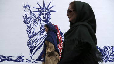 A cartoon of the Statue of Liberty forms part of anti-US murals painted on the wall of the former American embassy in Tehran to commemorate the 40th anniversary of the takeover.