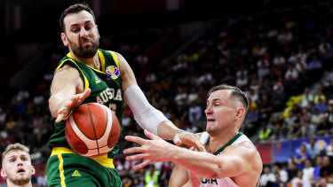Australia's Andrew Bogut intercepts a pass by Paulius Jankunas of Lithuania.