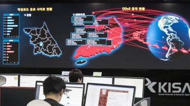 Employees watch electronic boards to monitor possible WannaCry ransomware cyber attacks at the Korea Internet and Security Agency in Seoul, South Korea.