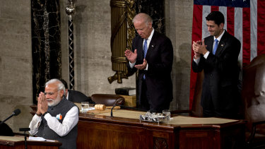 Narendra Modi, India's prime minister, left, gestures after speaking to a joint meeting of Congress with former US House Speaker Paul Ryan and then Vice President Joe Biden, at the US Capitol in Washington in 2016.