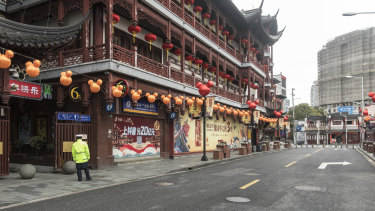 A security guard stands outside the Yuyuan Bazaar in Shanghai.