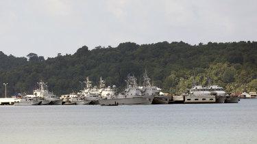 Ships and boats sit moored at the Ream Naval Base near Sihanoukville, Cambodia.