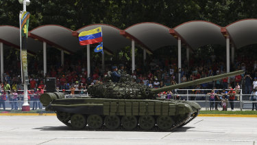 A tank drives past during a Venezuela Independence Day military parade in Caracas.