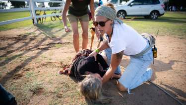The 61-year-old NSW woman was left sprawled on the ground after being hit by the gate.