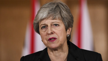 Thrown to Britain's lions: Prime Minister Theresa May.