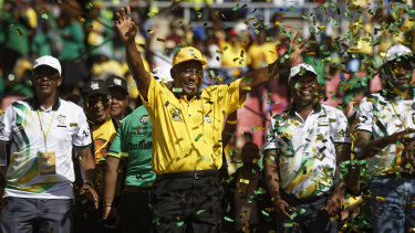 South Africa President Cyril Ramaphosa gestures to supporters after finishing his speech at his final election rally in Johannesburg on Sunday.