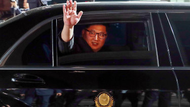 Kim Jong-un, North Korea's leader, waves from a limousine as he departs the inter-Korean summit at the village of Panmunjom in the Demilitarized Zone (DMZ) in Paju, South Korea in 2018.