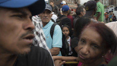 Commuters crowd onto a privately owned truck in Caracas as parts shortages cut into the available public transport in the once wealthy city.