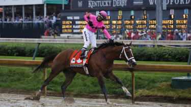 Maximum Security crosses the line first in the Kentucky Derby, but was disqualified.