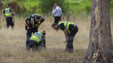 Police searching grassland for clues near the Polaris Shopping Centre.