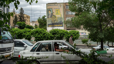 Commuters drive past a giant wall mural proclaiming the destruction of Israel in Tehran, Iran, on Wednesday.