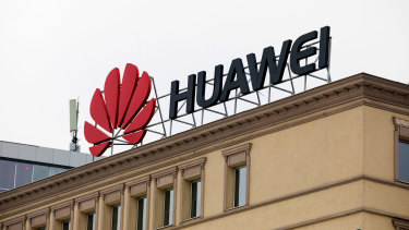 A sign advertises Huawei on a building on a city square in central Skopje, Macedonia.