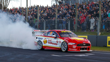 In a spin: Scott McLaughlin celebrates his record-breaking 17th win of the season in front of race fans.