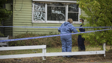 Forensics police outside the Grimshaw Street property in Bundoora on Friday.