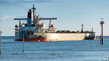 Two crew aboard a bulk carrier anchored of Port Hedland have tested positive to COVID-19.