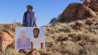 Vincent Namatjira with his work The Queen and Me.