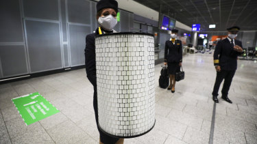 A Lufthansa crew member holds a high-efficiency particulate air (HEPA) cabin filter as the airline and airport operator Fraport AG, showcase new coronavirus safety measures at Frankfurt Airport in Germany.