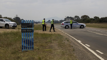 Police set up a road block at Little River Road.