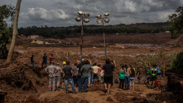 Residents survey damage after a Vale SA dam burst in Brumadinho, Brazil, on Saturday.