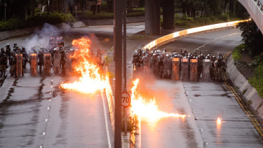 Protesters throw firebombs.