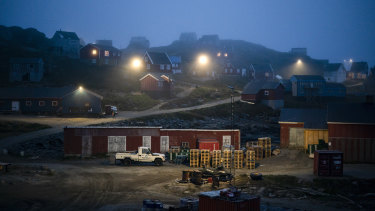 Early morning fog shrouds homes in Kulusuk, Greenland. As warmer temperatures cause the ice to retreat the Arctic region is taking on new geopolitical and economic importance.
