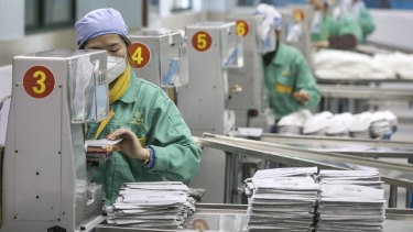 Face mask production at a factory in Shanghai. The pandemic has exposed the world's reliance on China for critical medical products and technology.
