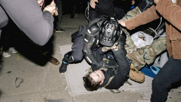 A New York City Police Department officer clashes with a demonstrator.