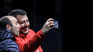 Matteo Salvini, leader of the League party, takes a selfie photograph with an attendee during a campaign rally in Maranello, Italy.