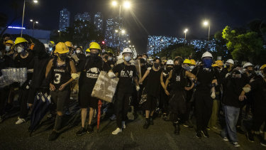 Demonstrators stand off against riot police during a protest in the Shatin district of Hong Kong on Sunday.