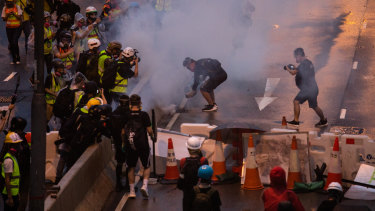 Riot police deploy tear-gas during the protests.