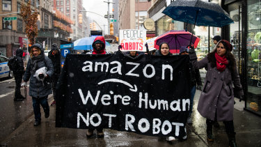 Amazon workers protested outside Jeff Bezos's NYC penthouse.