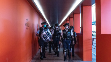 Hong Kong riot police patrol during a demonstration outside a shopping mall on Sunday.