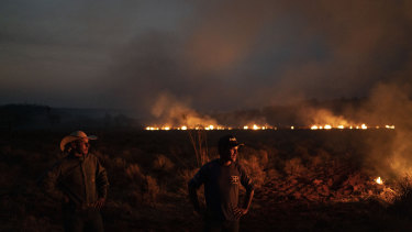 The battle against fire in the state of Mato Grosso, Brazil, in August. Under increasing international pressure to contain the fires sweeping parts of the Amazon, President Jair Bolsonaro authorised the military to battle the massive blazes.