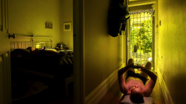 Christopher Pearce has resorted to lying on the floorboards of his home, in Sydney's Newtown, to beat the heat.