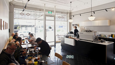 Kurumac's dove-grey walls, stained-glass windows, and soft raw wood tables provide a calming atmosphere in this Japanese-Australian cafe.