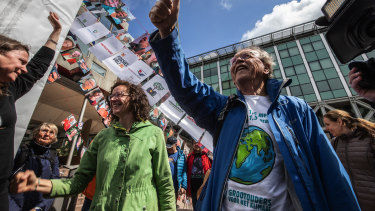 Environmental activists celbrate the verdict in the case against Shell in the Hague.