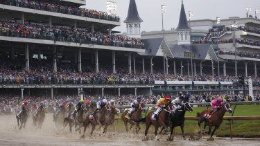 Maximum Security (far right) leads the Kentucky Derby before later becoming the first winner ever to be disqualified in the marquee race.